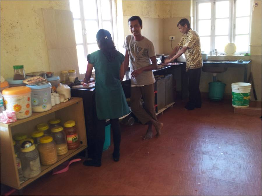 Suleman helping out in the Kitchen at the Rehabilitation Centre.